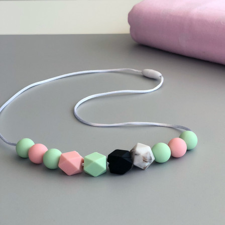 Love And Carry Lotus Collier de portage en silicone alimentaire